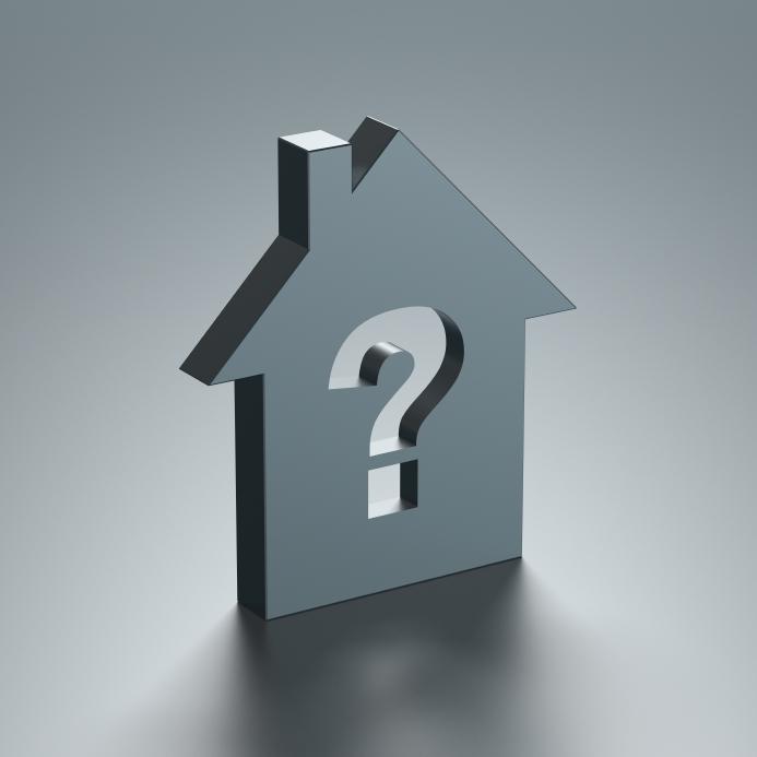 Foto van een huis met een vraagteken erin