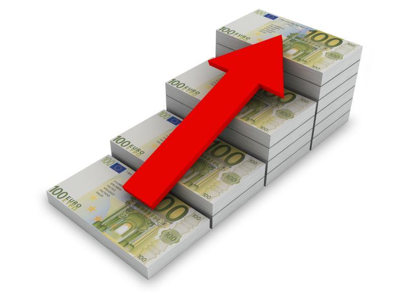 Afbeelding van stapels bankbiljetten die stijgen