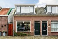 Foto van een aangekochte woning (Schoolmeestersstraat, Zaandam)